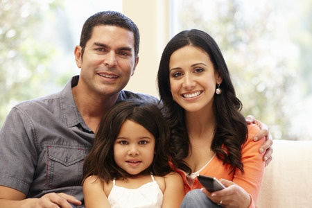 42109232 - hispanic family watching television