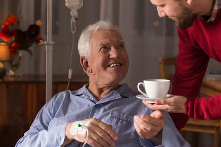 51794801 - male carer assisting incurable ill senior man
